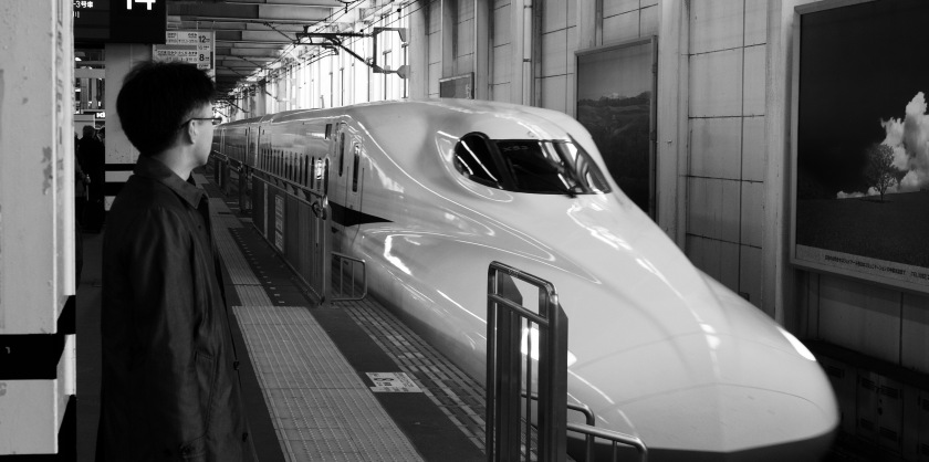 Businessman waits for the bullet train